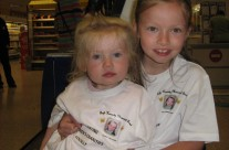 Roisin and Grace bag packing in their sister's memory
